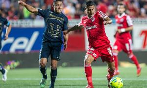 Tijuana hangs tough but loses to Pumas as Miguel Herrera looks on