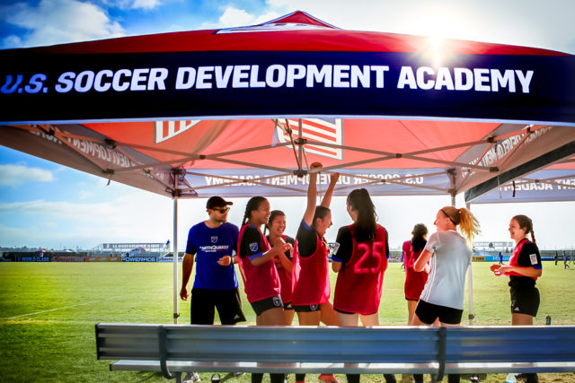 Why does the Development Academy Bar Players from High School Soccer